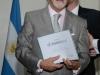 El Dr Horacio Martinez recibe la distinción a Osim